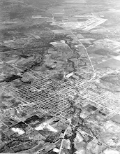 Photo: Aerial view of Beeville with Chase Field in the background 1958