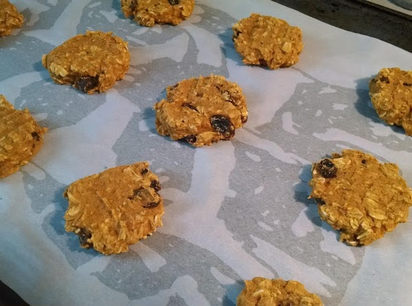 Scoop out 1 tablespoon of the mixture and put on cookie sheet. Flatten with...