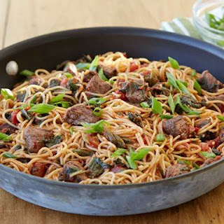 Stir-fried Steak and Tomatoes over Noodles.