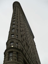 "Photo: North side of the Flatiron Building, 175 Fifth Avenue i. ""The Flatiron Building, designed by Daniel Hudson Burnham and standing 285 ft (87 m) high, was one of the tallest buildings in the city upon its completion in 1902, made possible by its steel skeleton."" 