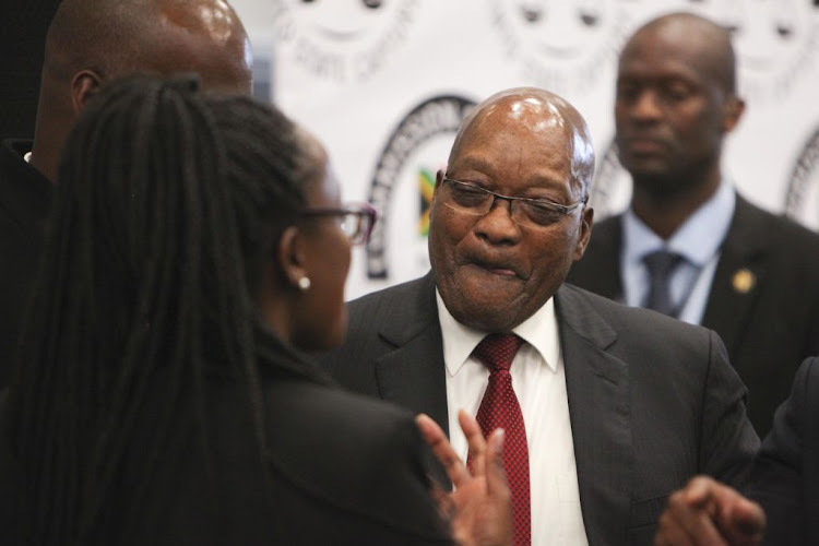Former president Jacob Zuma shares a lighthearted moment with his legal team at the state capture inquiry in Parktown, Johannesburg, on July 19 2019.