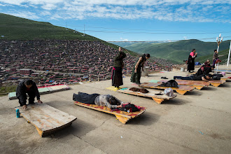Photo: Pilgrims prostrating in front of the new stupa at the ridge line.