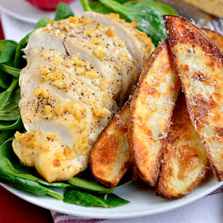 Parmesan-Garlic Chicken with Roasted Potato Wedges.