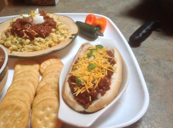 Warm Hot Dog buns if desired. Assemble chili dog and top with your favorite...