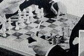 Photo: An even closer image of the catalin chess set from the advert - unfortunately, I still can't make out the nature of the piece to try to identify them! This is about as close-in as I can get without losing the image as just a series of pixels.