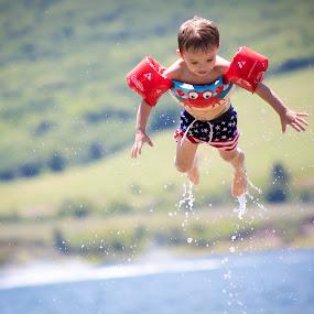 Flying by Richard States - Babies & Children Children Candids ( water, flying, happy, summer, boy,  )