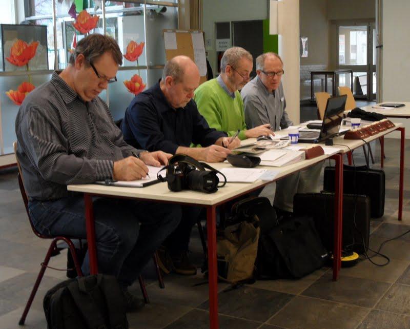 Photo: Panel bestaande uit (vlnr) Henk Vinkes, Rien Bos, Peter Goud en Jan Hummel