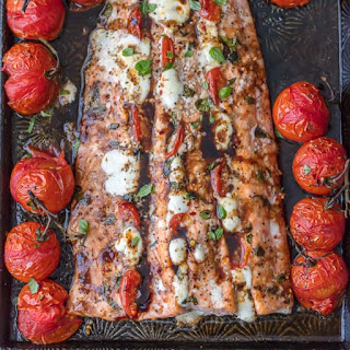 Caprese Stuffed Salmon with Balsamic Roasted Tomatoes.