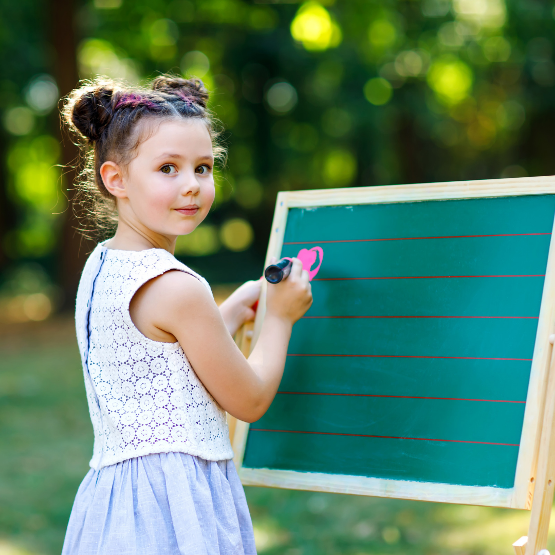 girl writing on a board