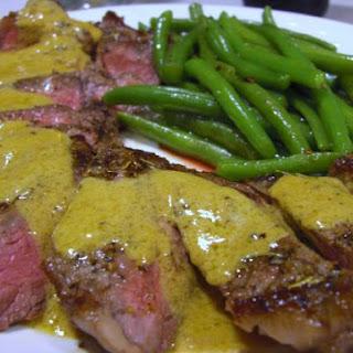 Pan-seared steak with IPA cream sauce.