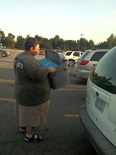 Photo: My hubby carrying all our goodies to the van!