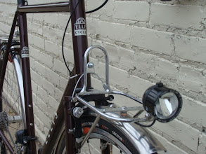 Photo: Custom Ellis front rack with internal headlight wiring.