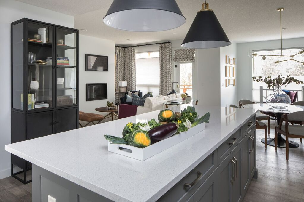 after, kitchen reveal, two-toned counter and cabinetry, amazing gold and gray pendant lights