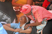 Grief-stricken Puleng Mphehlo  during the memorial   for her brother Tshepo, who was stabbed at school.