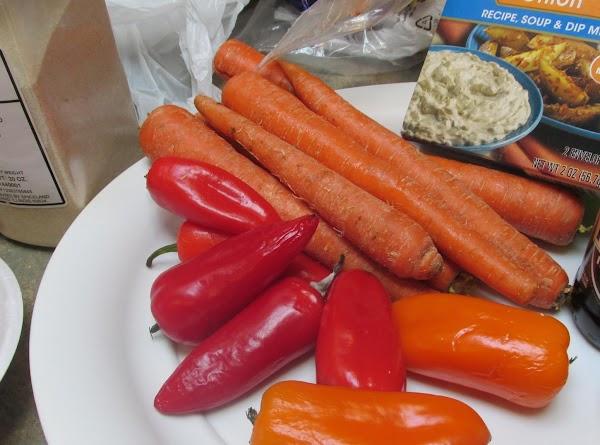 Now arrange sweet peppers around roast in dutch oven around perimeter of the roaster.