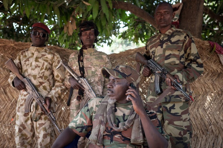 The self-proclaimed General Ahamat Bahar, ex-Seleka, ex-FPRC (Front populaire pour la renaissance de la Centrafrique), ex-MPC (Central African Patriotic Movement) co-founder, and now leader of the armed group MNLC, poses for photographs in front of his home in Betoko, northern Central African Republic, on December 27, 2017.