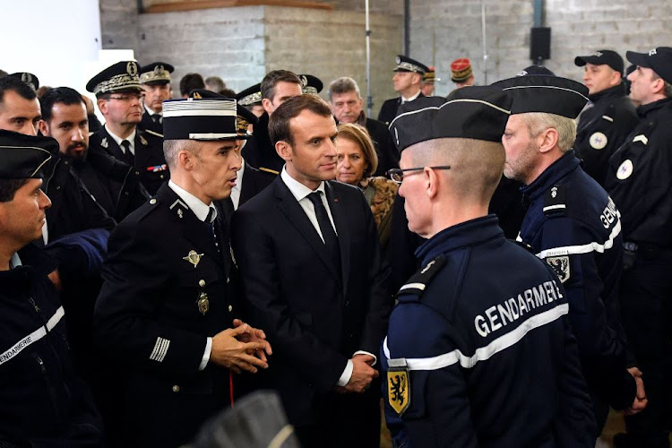 French President Emmanuel Macron meets gendarme and police forces during his visit to Calais, France, January 16 2018. Picture: REUTERS