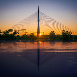 Bridge at Sunset by IP Maesstro - Buildings & Architecture Bridges & Suspended Structures ( sky, sunset, bridge, sunrise, landscape, sun )
