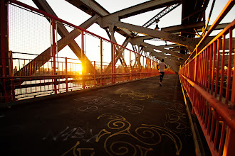 """Photo: """"The sun's glow...""""  When the sun sets in the winter, its light pours over the city like the glow from a distant bonfire with scattered light illuminating the grey, steel edges like embers strewn about in the wind.    I took this image yesterday with the Sony a99 while walking over the Williamsburg Bridge. The Williamsburg Bridge is a favorite of mine in lower Manhattan. It tends to be overshadowed by the Brooklyn Bridge and Manhattan Bridge when it comes to popularity. This is probably because its pedestrian walkway is completely enclosed by a metal gate and because it isn't in super close proximity to the other two bridges (although one could argue that the pedestrian entrances to all three bridges are in walking distance to each other).  However, it definitely lives up to its National Historic Civil Engineering Landmark status. Its architecture is incredible and the views of the New York City skyline and Brooklyn that can be glimpsed from either walkway are stunning.    You can view this post along with all relevant links over at my photography blog if you wish here:  http://nythroughthelens.com/post/40924327279/the-williamsburg-bridge-at-sunset-new-york  -  Tags: #photography  #nyc  #newyorkcity  #newyorkcityphotography  #nycphotography  #williamsburgbridge  #bridge  #bridgesaroundtheworld  #architecture  #architecturephotography  #streetphotography  #graffiti  #manhattan  #sunset  #sunsetsaturday"""
