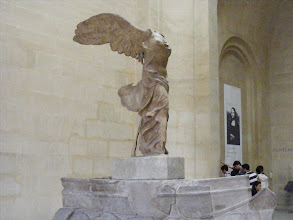 Photo: A stop at one of the classics, The Winged Victory of Samothrace, a third century BCE marble sculpture of the Greek goddess Nike (Victory). Following its 1863 discovery by the French consul and amateur archaeologist Charles Champoiseau, Victory was sent to Paris, where it has been prominently displayed at the Louvre since 1884. Despite its significant damage and incompleteness, the Victory is considered to be one of the great surviving masterpieces of sculpture from the Hellenistic period, with a mastery of form and movement which has impressed critics and artists everywhere. It is considered one of the Louvre's greatest treasures, and is displayed in dramatic fashion at the head of the sweeping Daru staircase. The loss of the head and arms, while in a sense regrettable, is thought by many to enhance the statue's depiction of the supernatural.