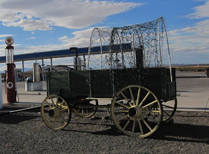 Photo: Old pioneer covered wagons... parked at the modern Chevron fuel station.
