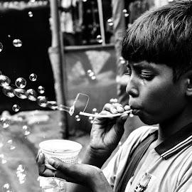 The bubble boy by Sayantani Ghosh - Babies & Children Child Portraits ( #childhood #bubbles #livelihood #street #kolkata )