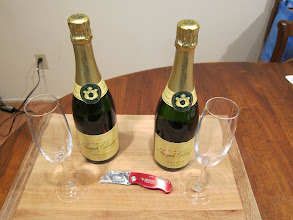 Photo: The solution: two bottles of champagne, two glasses, a blade and/or tape.