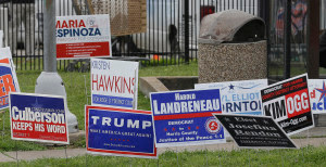 Photo: A lone sign support in Republican presidential candidate Donald Trump sits outside a polling place on election day, Tuesday, March 1, 2016, in Houston. (AP Photo/Pat Sullivan)