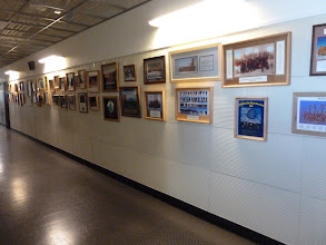 Photo: Pictures along the walls at the main entrance, lower level.