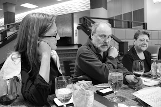 Photo: Cas Fricke, dale Sherman and Ann Atkinson working late in board room