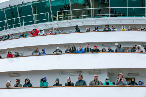 Passengers at the bow of ms Oosterdam taking in Hubbard Glacier during an Alaska sailing.