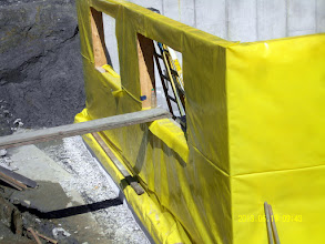 """Photo: S. side: 2"""" stone over drains & below footing foam, wrapped footings & walls."""