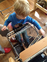 Photo: a focused boy  weaving.