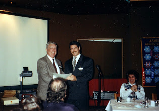 Photo: Chapter President Ross McIntyre (right) presents the Life Membership Certificate to David Palmer