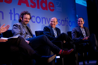 """Photo: Michael Sheen, Howard Gordon and David Nevins share a laugh during the """"Hollywood and Policy"""" panel discussion Friday, Nov. 16 at the RAND Politics Aside event in Santa Monica."""