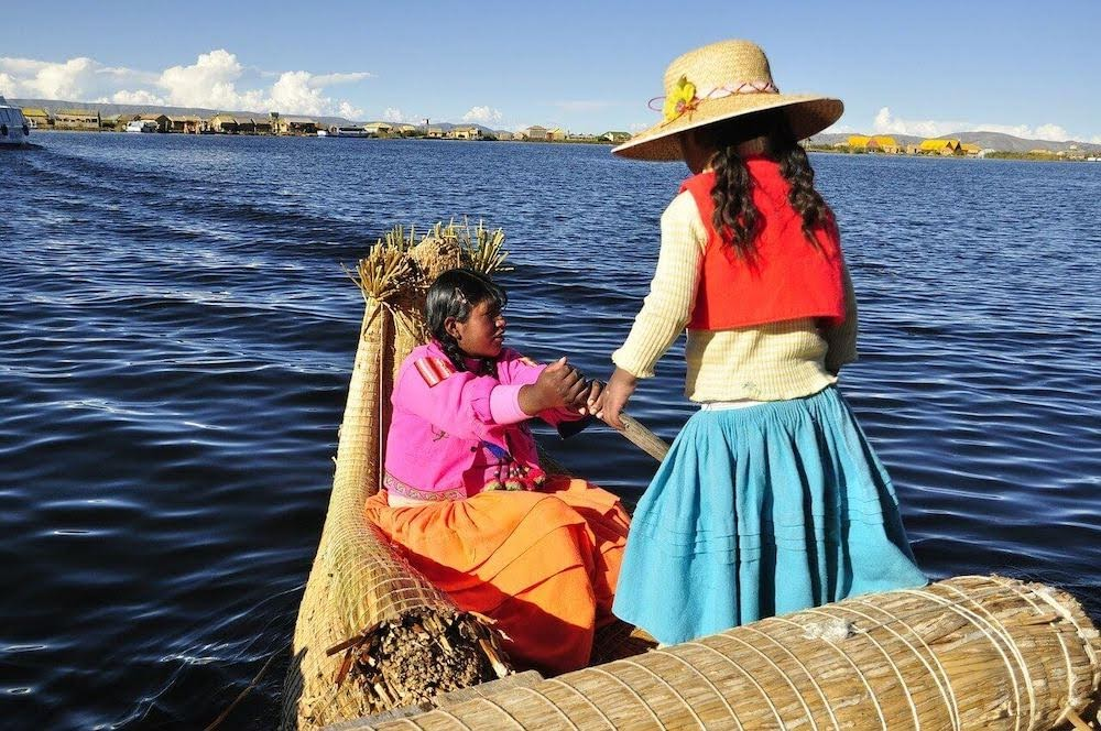 little girls on reed boats in titicaca lake in bolivia.jpg
