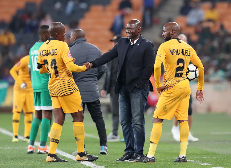 Bloemfontein Celtic coach Steve Komphela chats to his former players Willard Katsande and Ramahlwe Mphahlele during the Absa Premiership match against Kaizer Chiefs at the FNB Stadium, Johannesburg on August 29 2018.