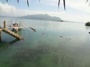 Photo: Nick and Tony looking for seahorses at the boat dock at Chindonan Island Resort, Palawan, Philippines.