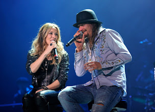 "Photo: DETROIT, MI - JANUARY 15:  (Exclusive Coverage) Sheryl Crow and Kid Rock perform during his ""Born Free"" tour opener at Ford Field on January 15, 2011 in Detroit, Michigan.  (Photo by Kevin Mazur/WireImage)"