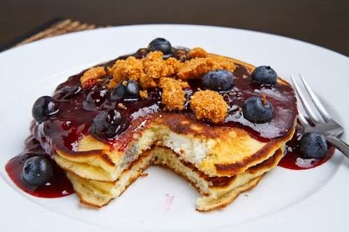 """Blueberry Cheesecake Pancakes""""Blueberry cheesecake inspired pancakes stuffed with chunks of cream cheese..."""