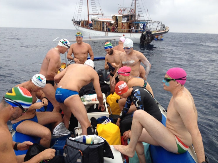 Some of the swimmers about to jump off a rubber duck just before the start, with the Wild Oceans support vessel Angra Pequena in the background.