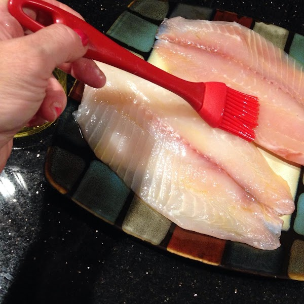 IN A SMALL DISH COMBINE BOTH OILS N BRUSH ON BOTH SIDES OF TILAPIA...