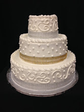 Photo: 3-tier cake featuring Town&Country w/dot border on top and bottom tiers, and single polka dots on middle tier. Gold & silver diamond wrap around each tier (provided by customer).