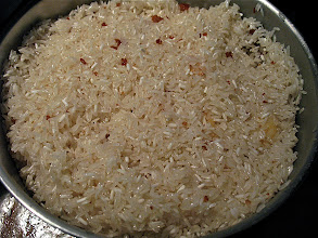 Photo: rice fried in chicken fat with garlic ready for steaming