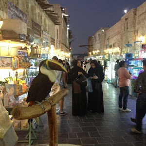 Women in abaya at a bazaar in Doha Qatar while out shopping