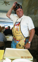 "Photo: ""Chef"" Larry Pisarick displays his fisherman cooking garb while serving at the Annual Fishing Club Clambake."