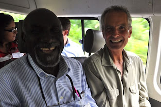 Photo: Taking the bus to the field - Herman Adams from CARDI, and John Jolliffe from the Better U Foundation