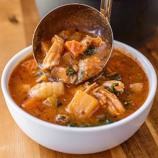 Hearty Italian Chicken and Autumn Veggie Soup with Roasted Garlic and Tomato Broth over Gnocchi.