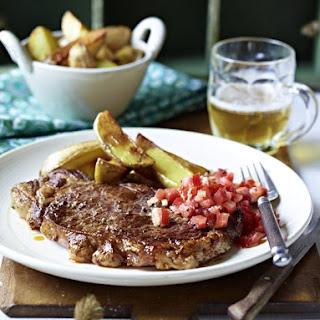 Steak with Tomato Horseradish Relish and Potato Wedges.