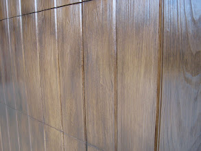 Photo: Is this wood or Wood Free? Don't worry if you can't tell the difference. Just check back in 2 years and you will see that the door isn't faded and splitting.